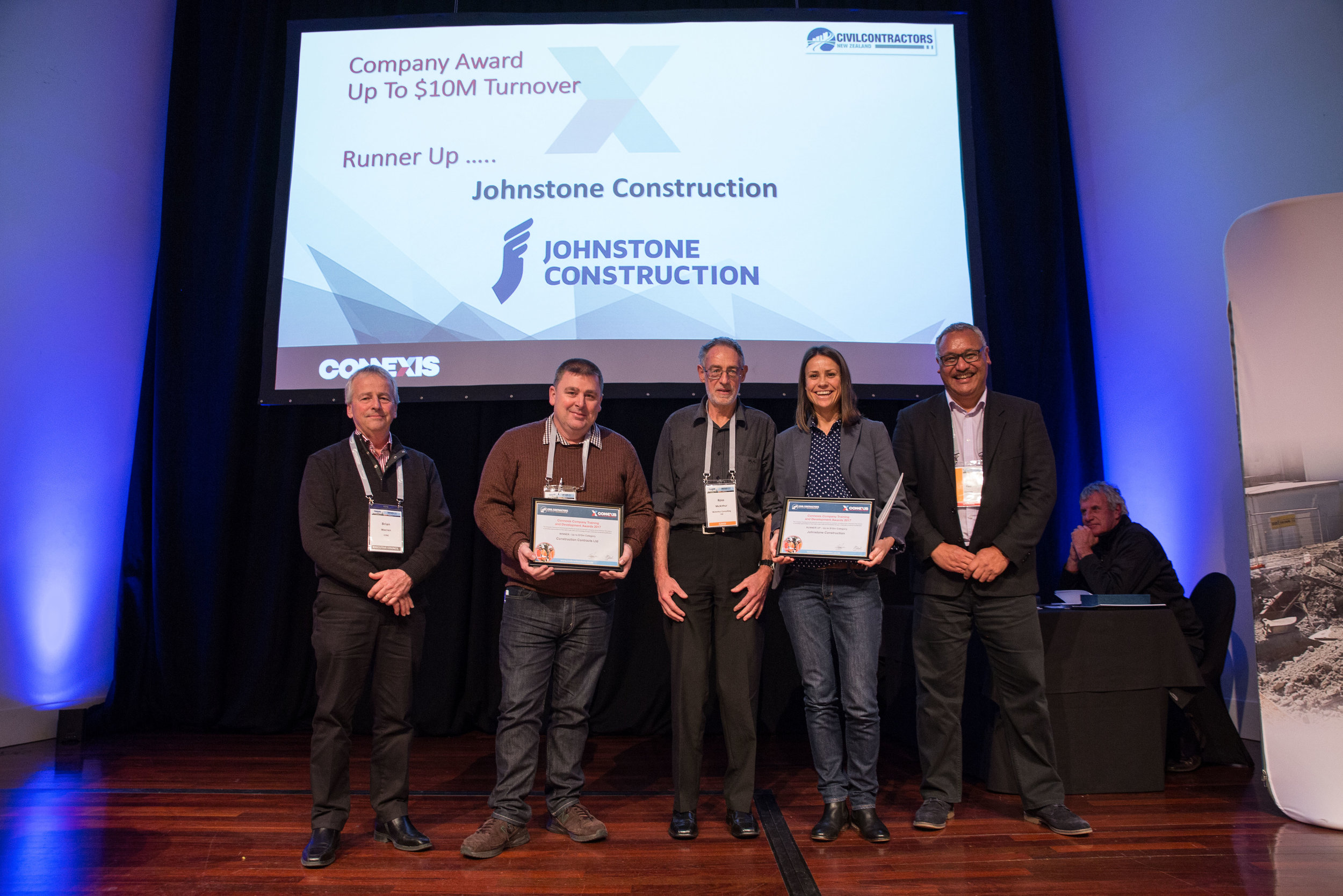 Johnstone Construction's Operations Manager Susy Pryde collects the 'Runner Up' certificate on behalf of Johnstone Construction at the 2017 CCNZ Awards