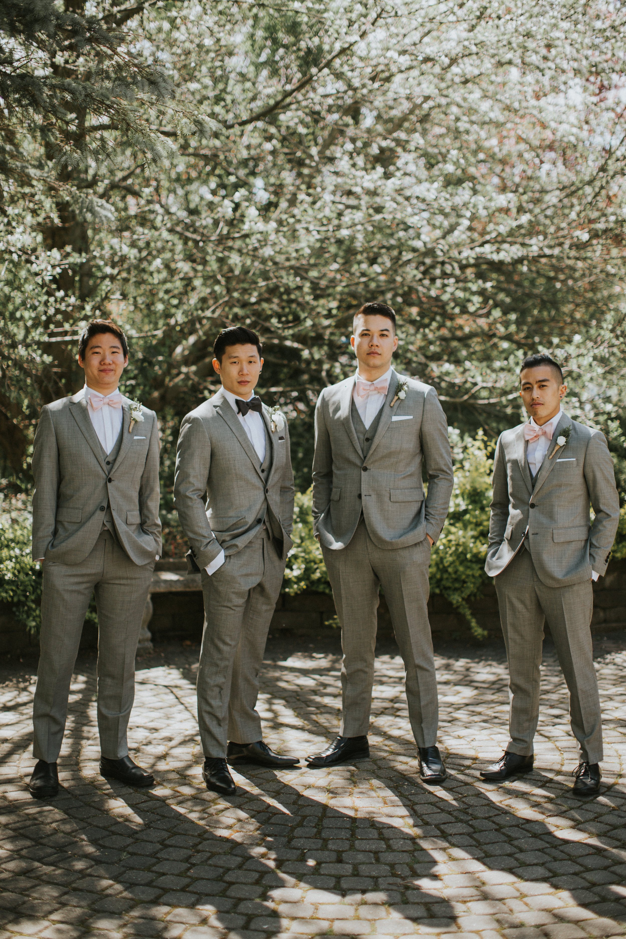 groomsmen portraits outside at Madsen's greenhouse
