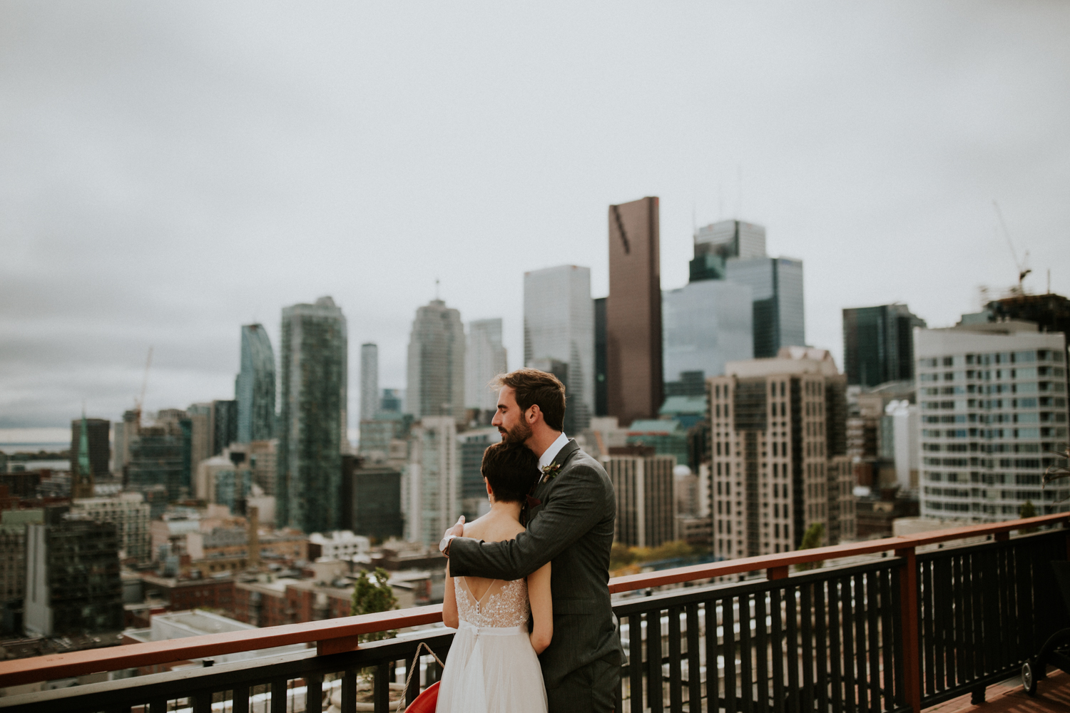 rooftop photo shoot of bride and groom cuddling