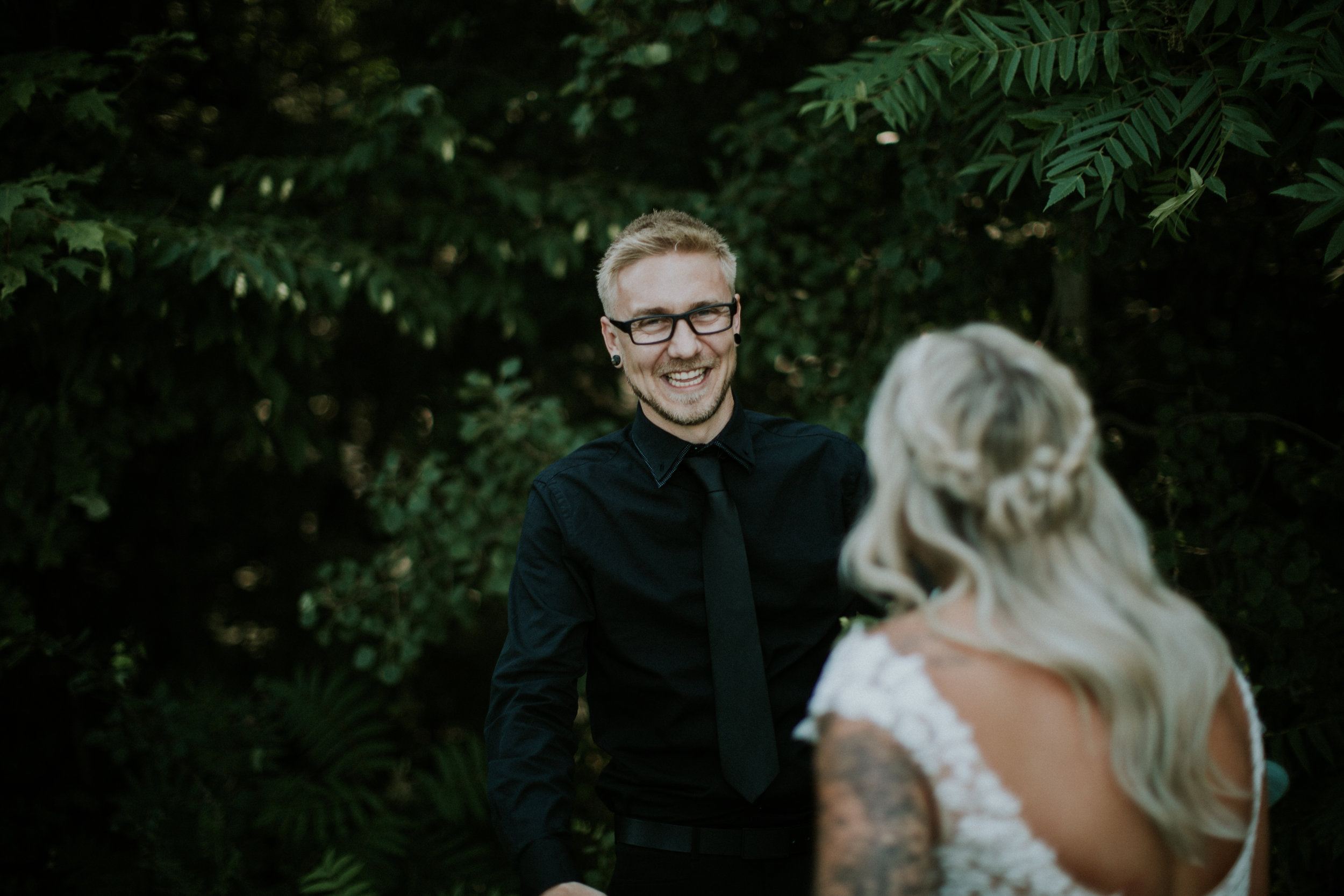 Groom seeing his bride for the first time during their first look