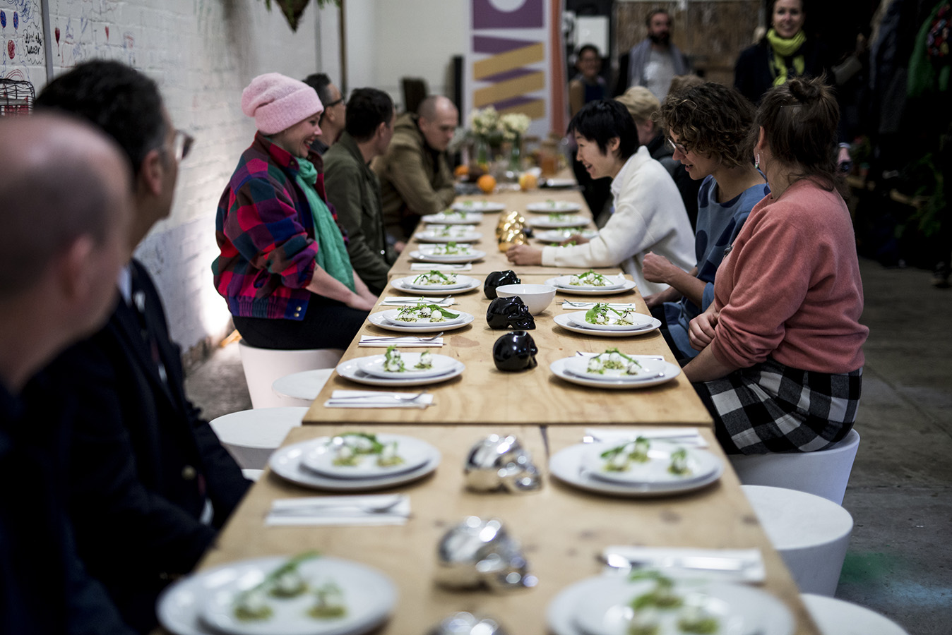 Biennial Lab artists and guests sit down to eat their meal, guided by Chef Peter Gunn. Photo: Pheobe Powell.