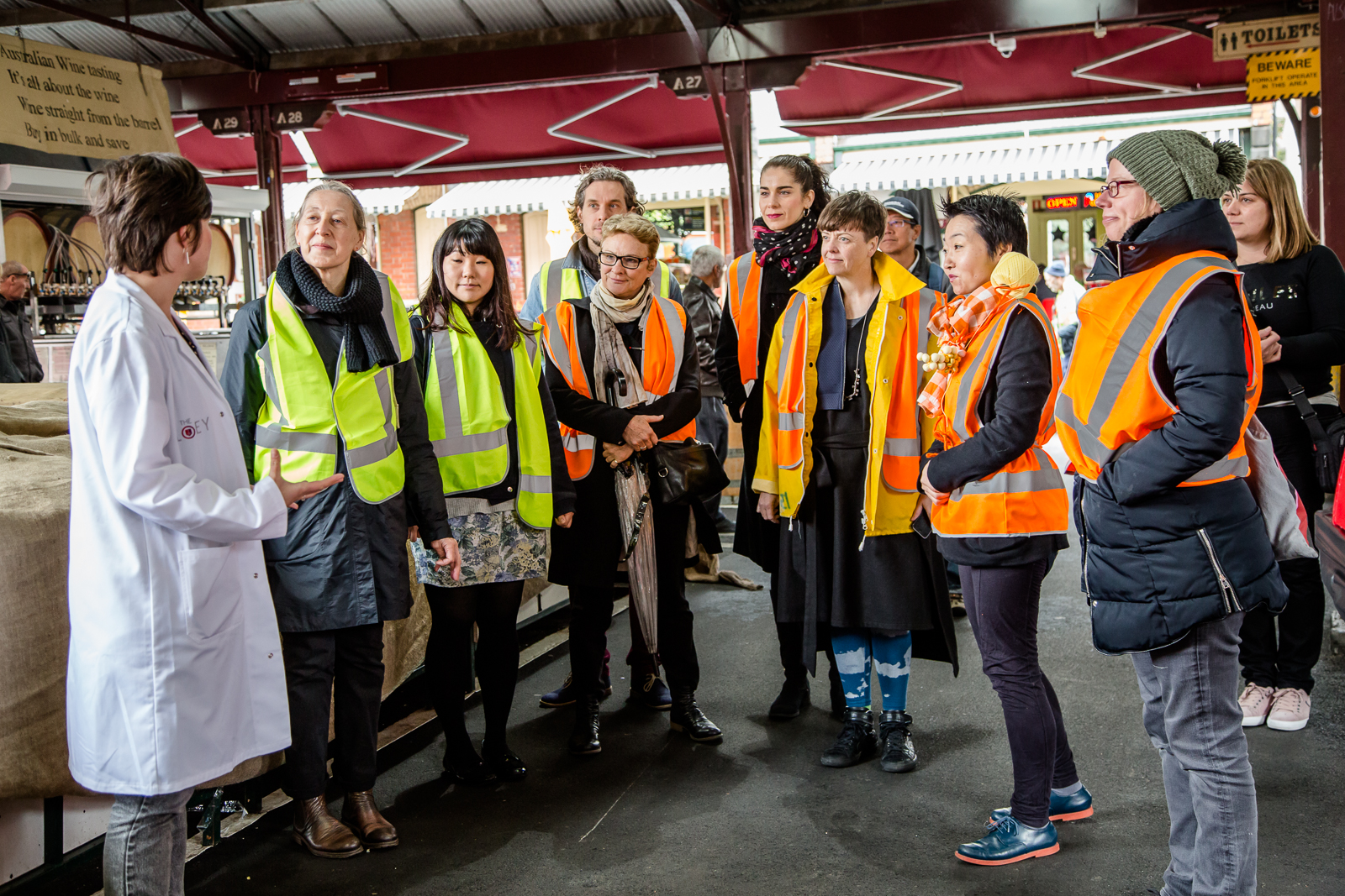 Dr Emma Burrows leads a walk through the Queen Victoria Market, as part of a talk with Hiromi Tango and Natalie King. Photo by Bryony Jackson.