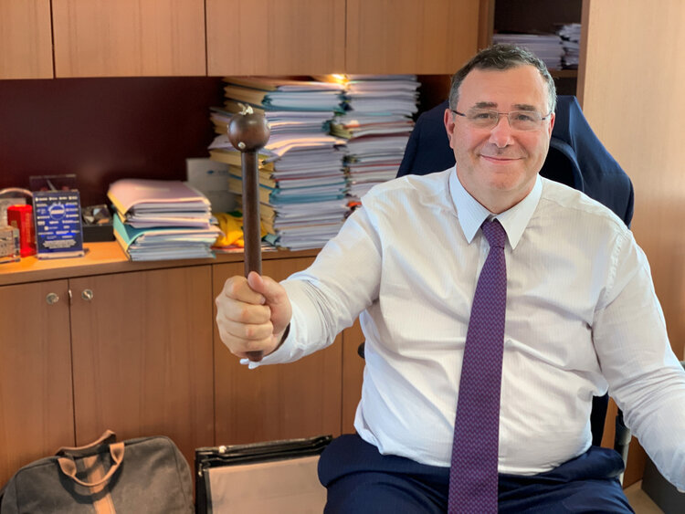 Patrick Pouyanné, Chairman & CEO of Total pictured holding the Africa Oil Legend Baton from 2019. The baton is encrusted with silver pangolins and was designed by the renown Patrick Mavros.