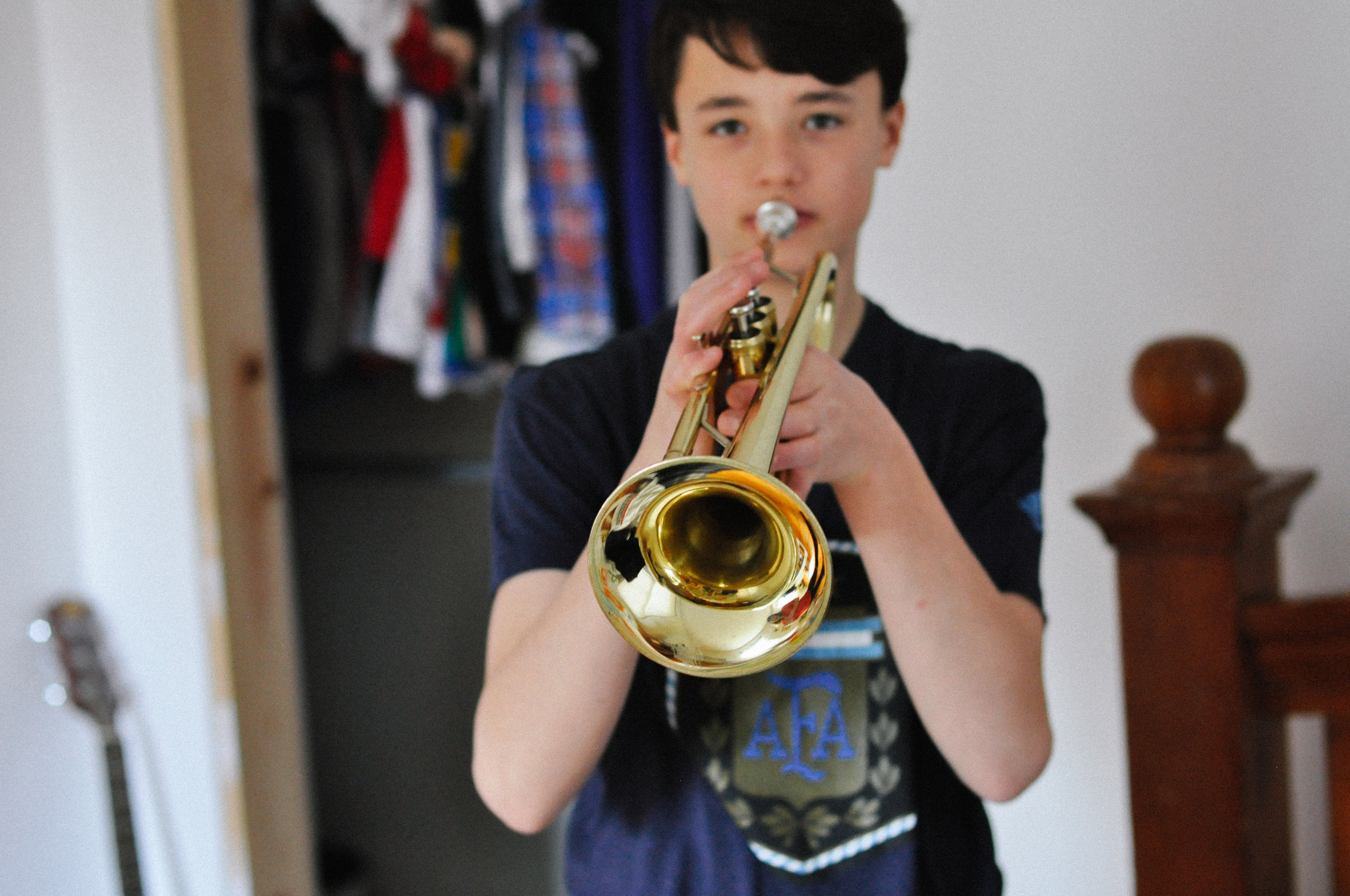 creative-family-in-home-session-farmhouse a boy and his trumpet 3.jpg