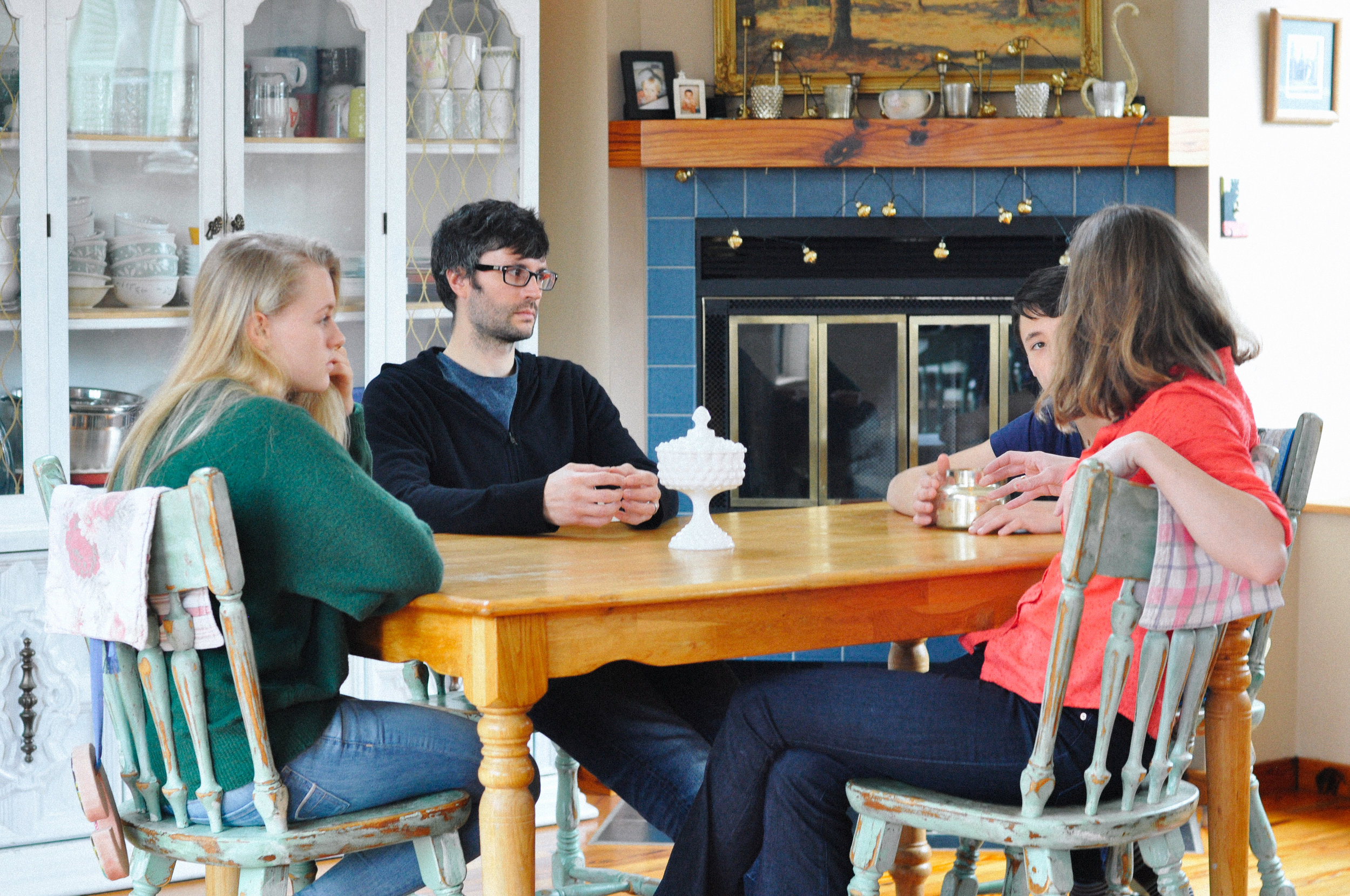 creative-family-in-home-session-farmhouse at the kitchen table 1.jpg
