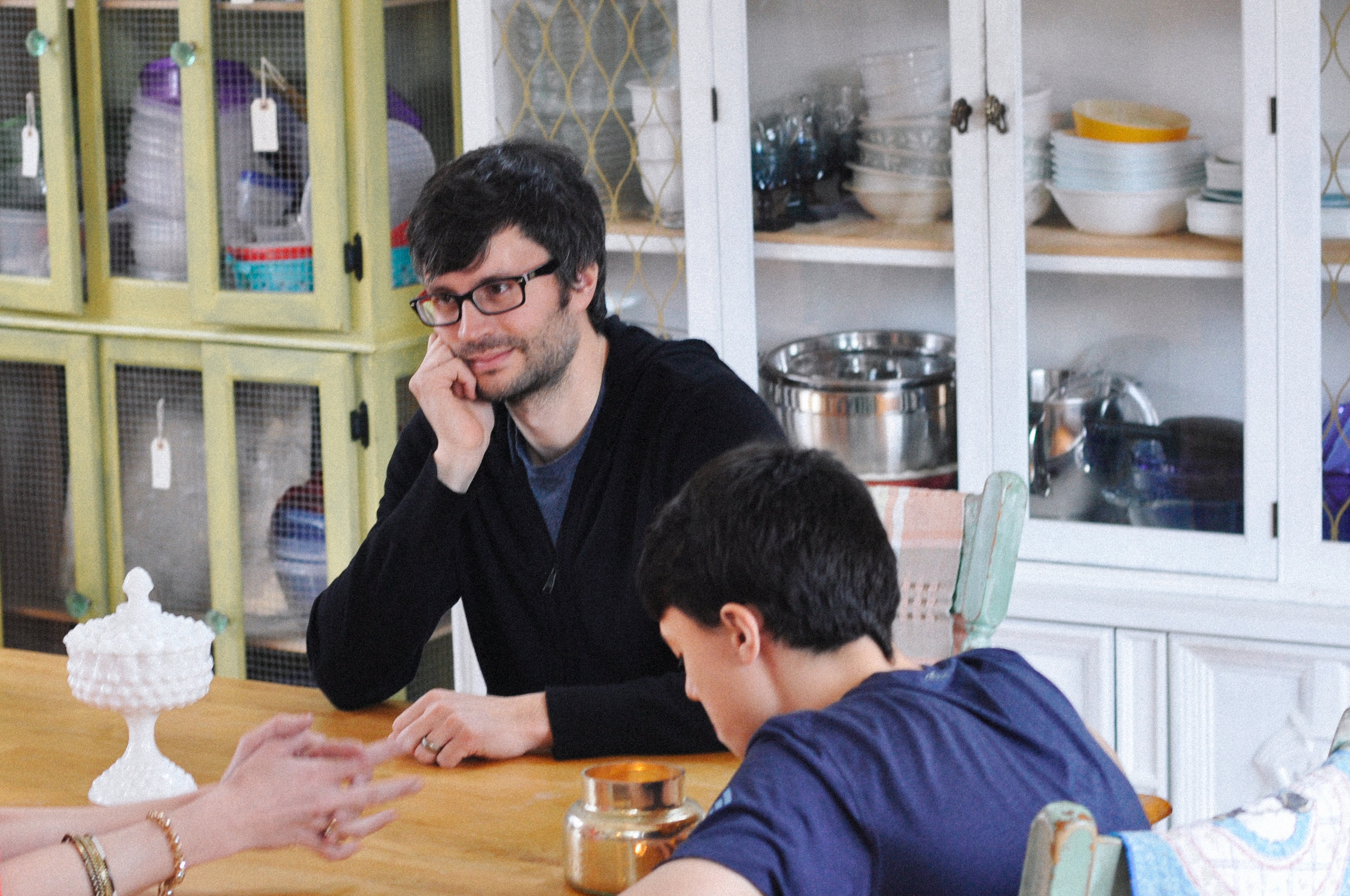 creative-family-in-home-session-farmhouse at the kitchen table matt looking.jpg