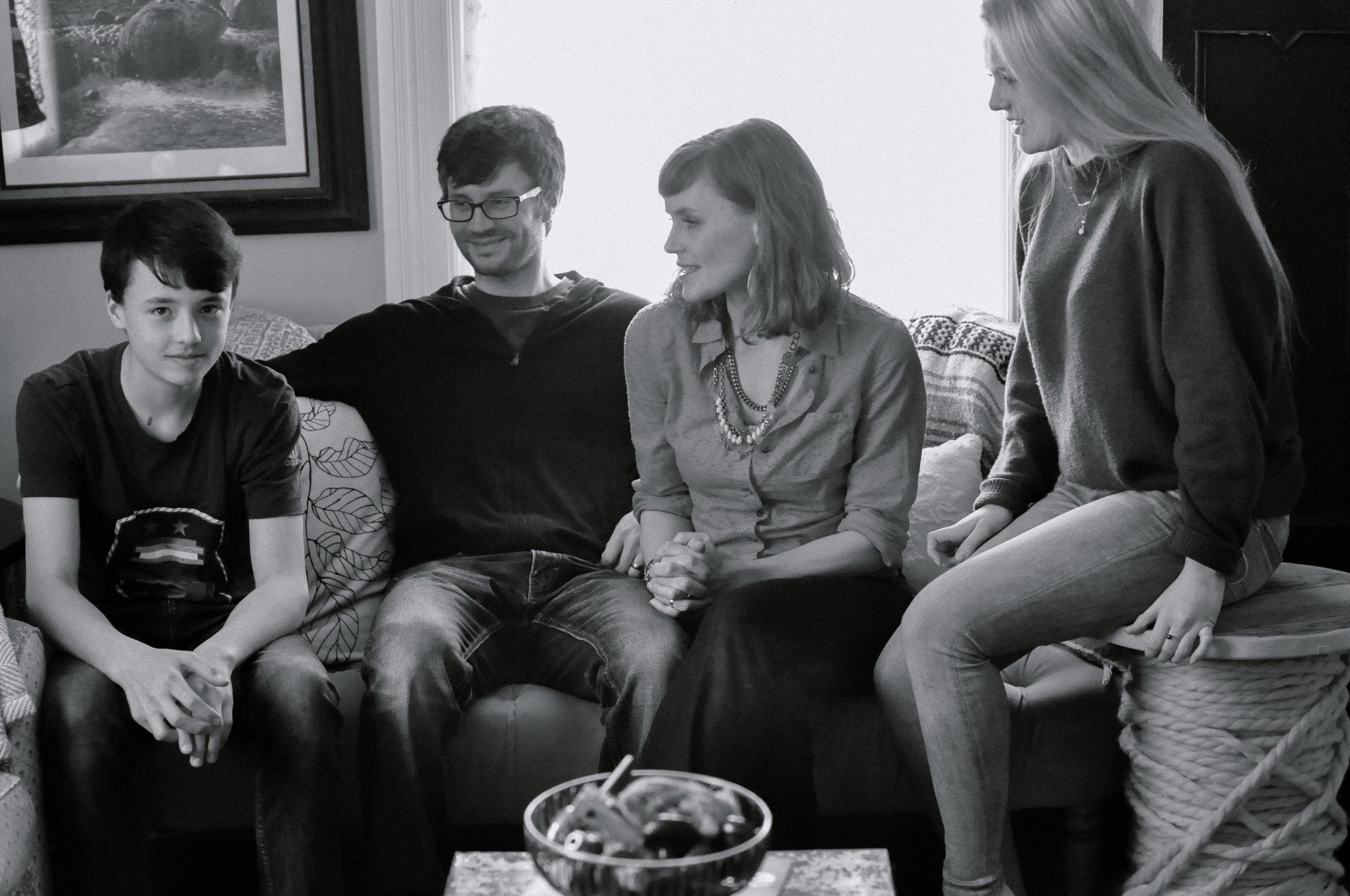 creative-family-in-home-session-farmhouse make him crack.jpg