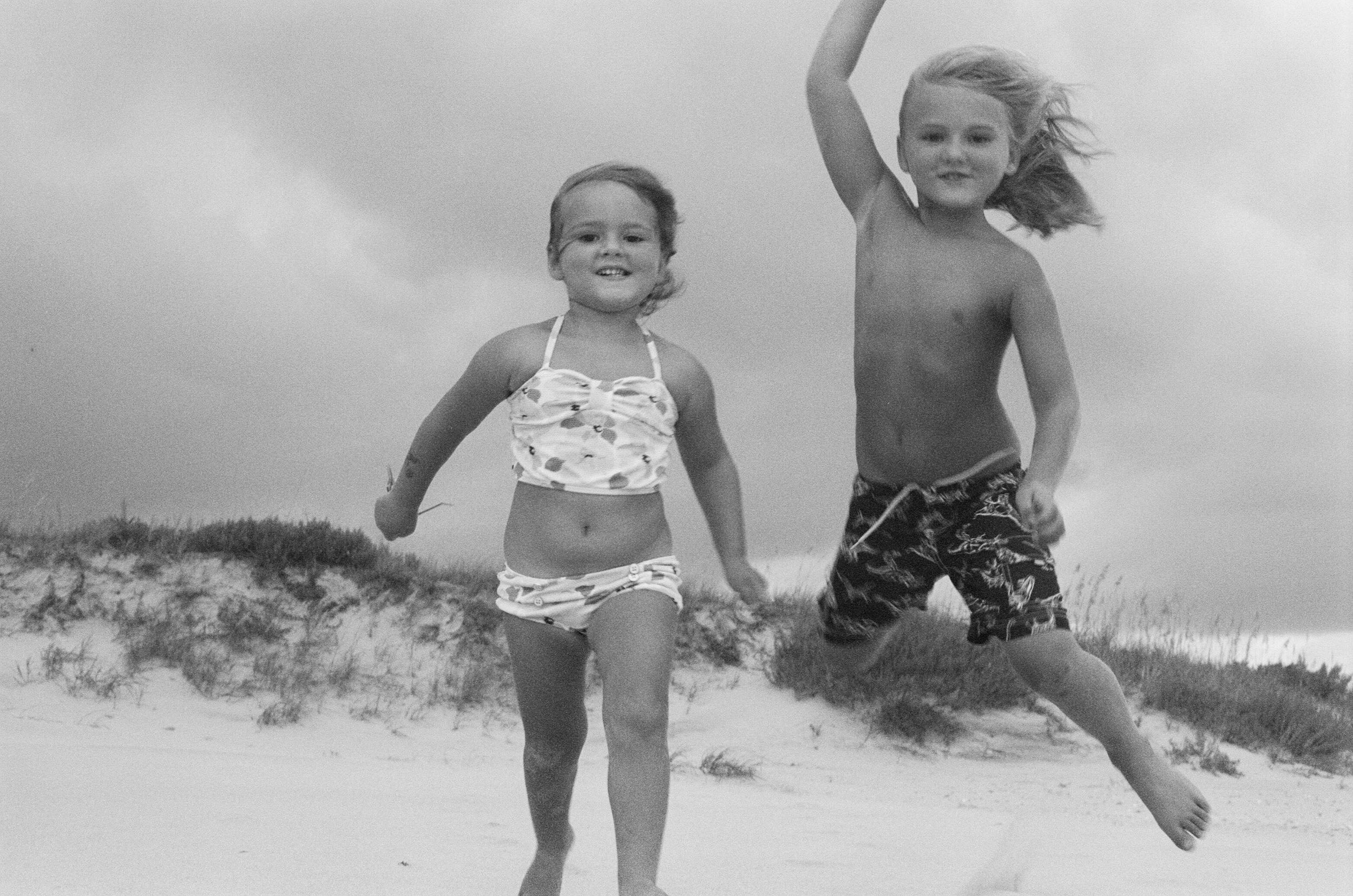 arlo and alamae jumping on the beach.jpg