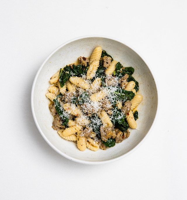 """Saturday Night Pasta - Malloreddus, sausage, cavolo nero and chilli. One of my favourite pasta shapes not only for the texture and ability to capture the sauce in their grooves but for the intensely therapeutic practice of rolling dough on a board over and over again.  And so it appears the sign of a good wife too. """"On her wedding night, a Sardinian bride will parade through town wearing silver jewellery, and carrying a large basket of Malloreddus made by her own hand. She is closely followed by her family until she reaches the doorstep of her betrothed, who will scare off her entourage with rifle-shots. The bride will then enter, to dine on her Malloreddus off the very plate as her new husband"""" as told by Geometry of Pasta. @nik_to  #Saturdaynightpasta"""