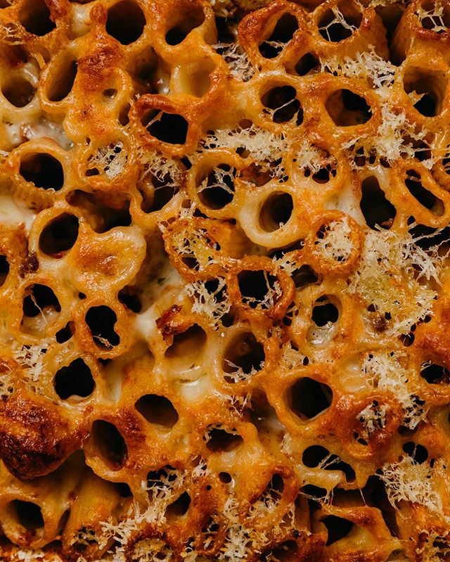 Cheesy, crunchy, comforting. My rigatoni pasta bake takes advantage of left over ragu from #saturdaynightpasta.  Cook rigatoni to al dente, not a minute more. Toss with hot ragu. Squish into a dish, trying to get the pasta to stand up which gives the cheese tubes to drip down. Blanket with cheese - mozzerella, parmigiano, I'd even be inclined for a bit of cheddar. Bake until golden. #SNP