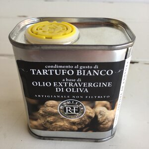 Truffle Oil.  Inside you will find the best quality Italian extra virgin olive oil infused with REAL white truffle.  Many commercial truffle oils use a synthetic aroma, poor quality oil and the result is frankly disappointing.  This little tin of intoxication will make the truffle lovers dreams a reality.