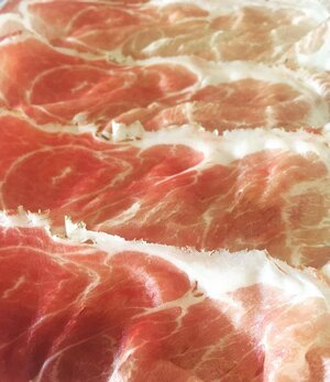 Prosciutto San Daniele.    Natural  because it is made only with meat from Italian pigs, sea salt and the fresh San Daniele air.  Genuine  because it has no hidden surprises, only a pristine environment and Mother Nature's magic; the highlands, Alps, Adriatic Sea, and the wind.