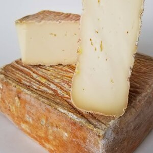 Quadrello.  This Tallegio style buffalo milk cheese has a pungent, savoury rind on the outside & a creamy, semi-firm texture inside with a beautiful sweet finish thanks to the rich buffalo milk. Delicious paired with a glass of Pinot Grigio or Pinot Noir.