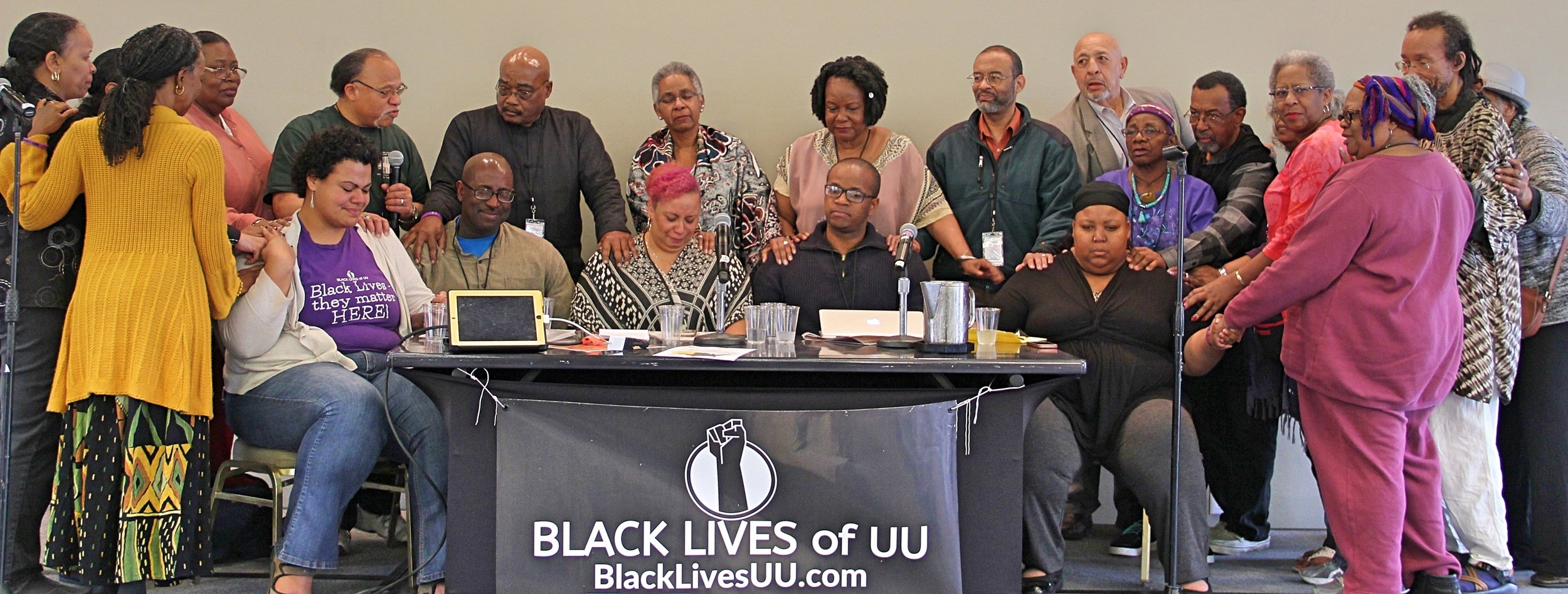 Black UU Elders lay hands and pray over the BLUU Organizing Collective in New Orleans, LA - February 2017