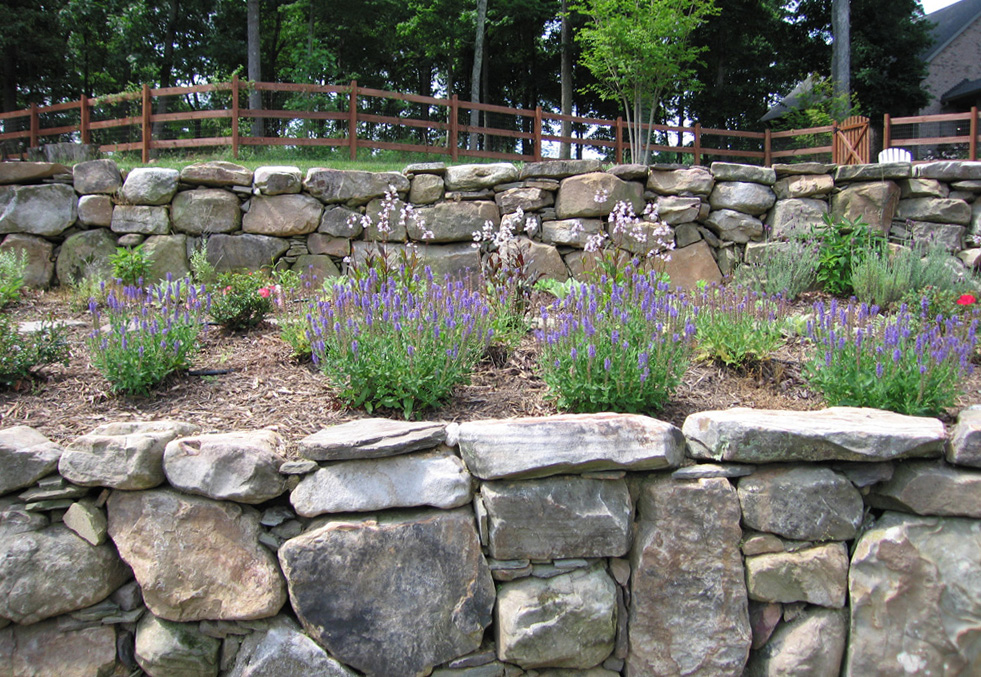 Stacked stone and boulder wall.