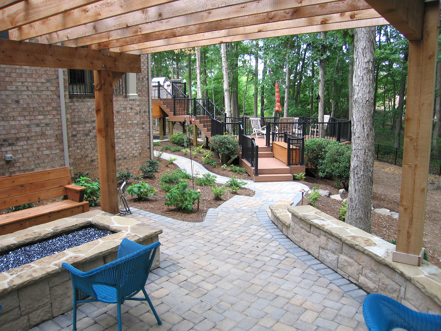 Ribbon fire feature with custom walkway and retaining walls with an arbor