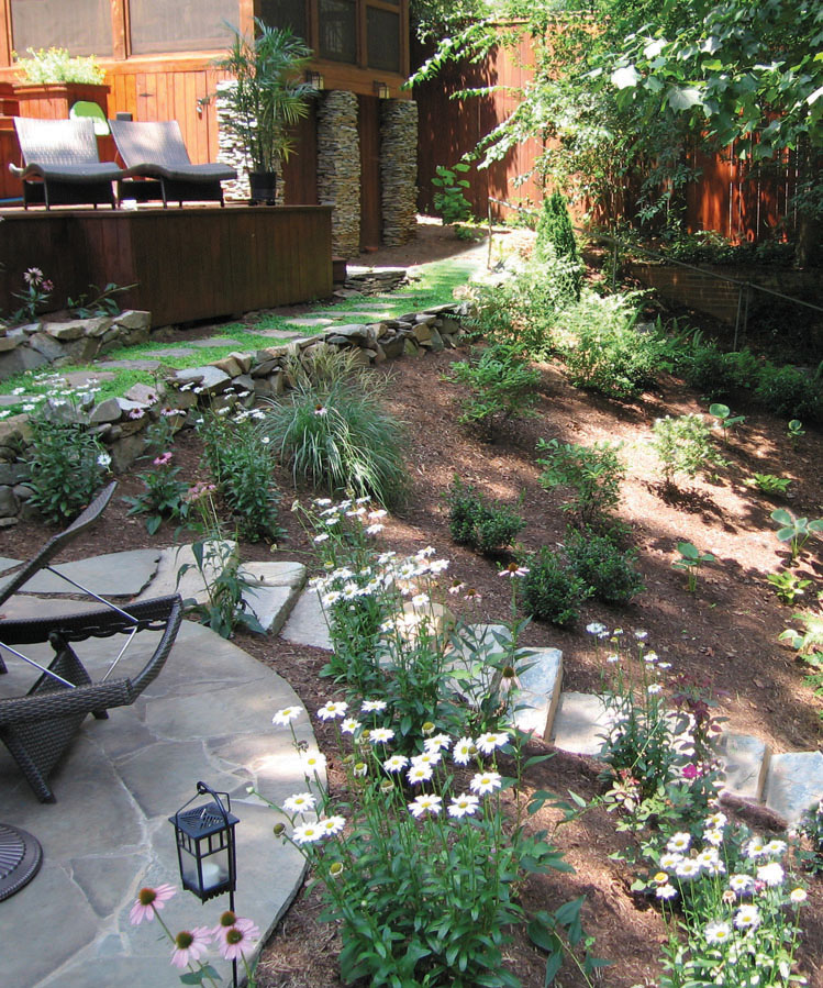 Sloped back yard steps with landscape design and installation