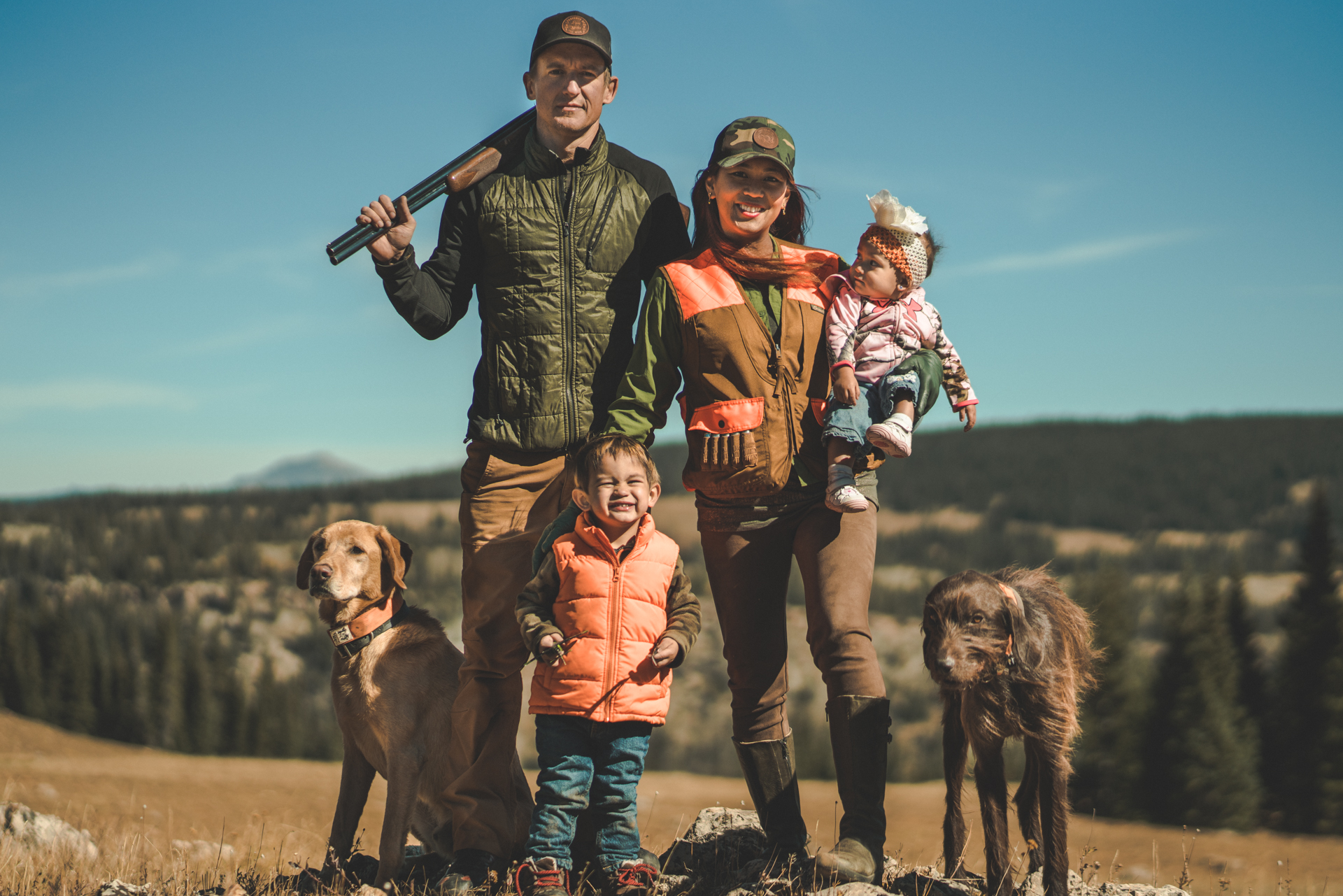 I took our family photo in grouse country because we hunt as a family. We were wearing our hunting clothes and I had my double barrel over my shoulder to help tell our story.