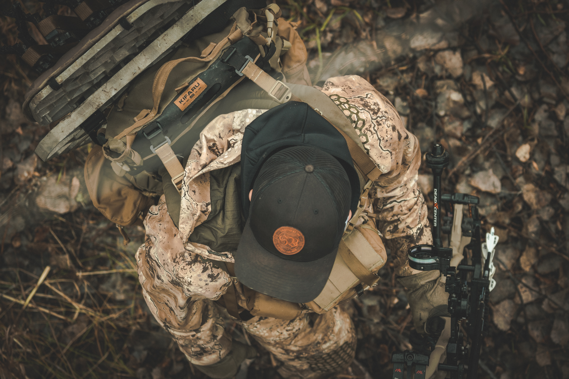Here's an angle we don't see everyday. I got up above this whitetail hunter and shot down while looking for a spot to place his stand. Variety goes a long way in photography.