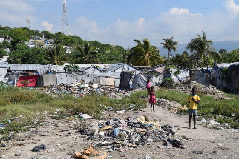 BEFORE  - unsafe latrines and a trash dump