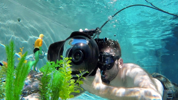 The shot (minus the fish) was created entirely in-camera. To protect him from the chlorine, the fish was shot separately in a freshwater container suspended within the pool to match angle and lighting.