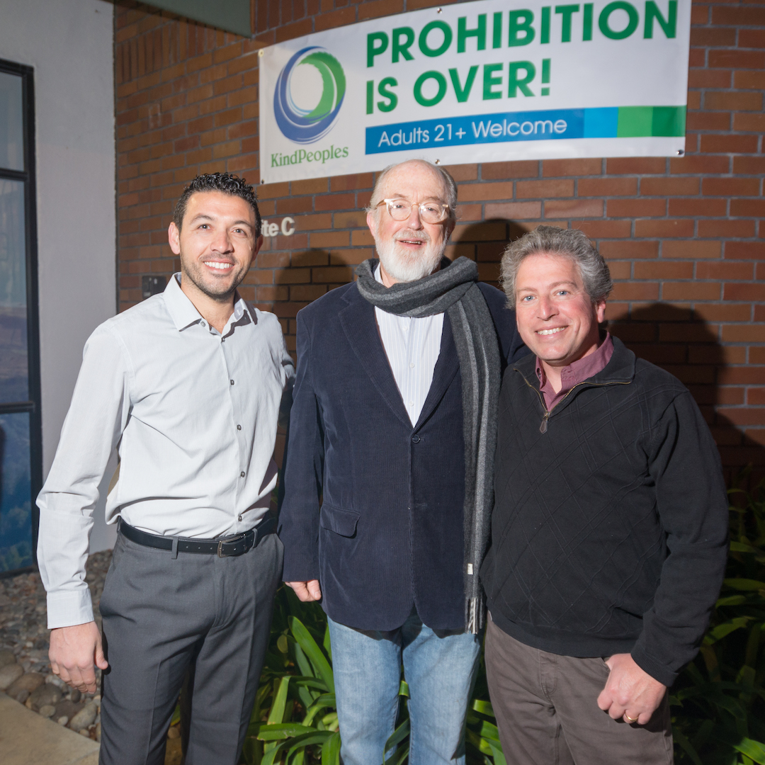 From left to right: KindPeoples Co-Founder Khalil Moutawakkil, UCSC Professor Emeritus Craig Reinarman and Santa Cruz County Supervisor John Leopold gather for the first fully legal cannabis sale early in the morning of January 1st.