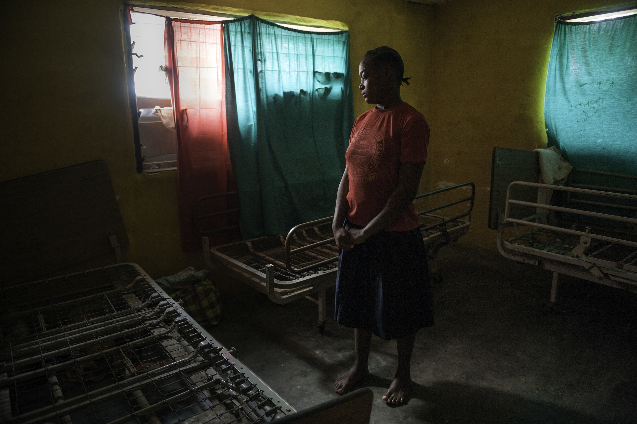 LIVING WITH FISTULA - Barbara Alfred, 15, lives in an orphanage in Monrovia, Liberia. She was raped by two of her uncles and left with a fistula that makes her unable to control her urine. She has been isolated from others at the orphanage and has been forced to sleep on only metal springs.