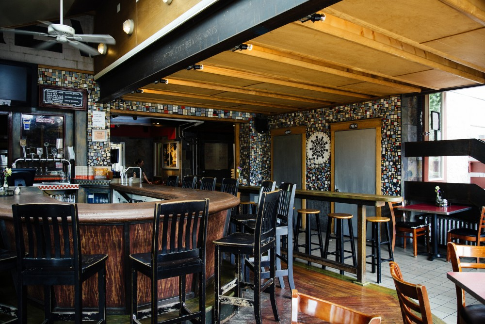 Motor City Brewing Works  Cass Corridor   Small brewpub with a warm vibe that serves brick oven pizza alongside their in house brewed seasonal beers.    470 W. Canfield 313.832.2700   Website