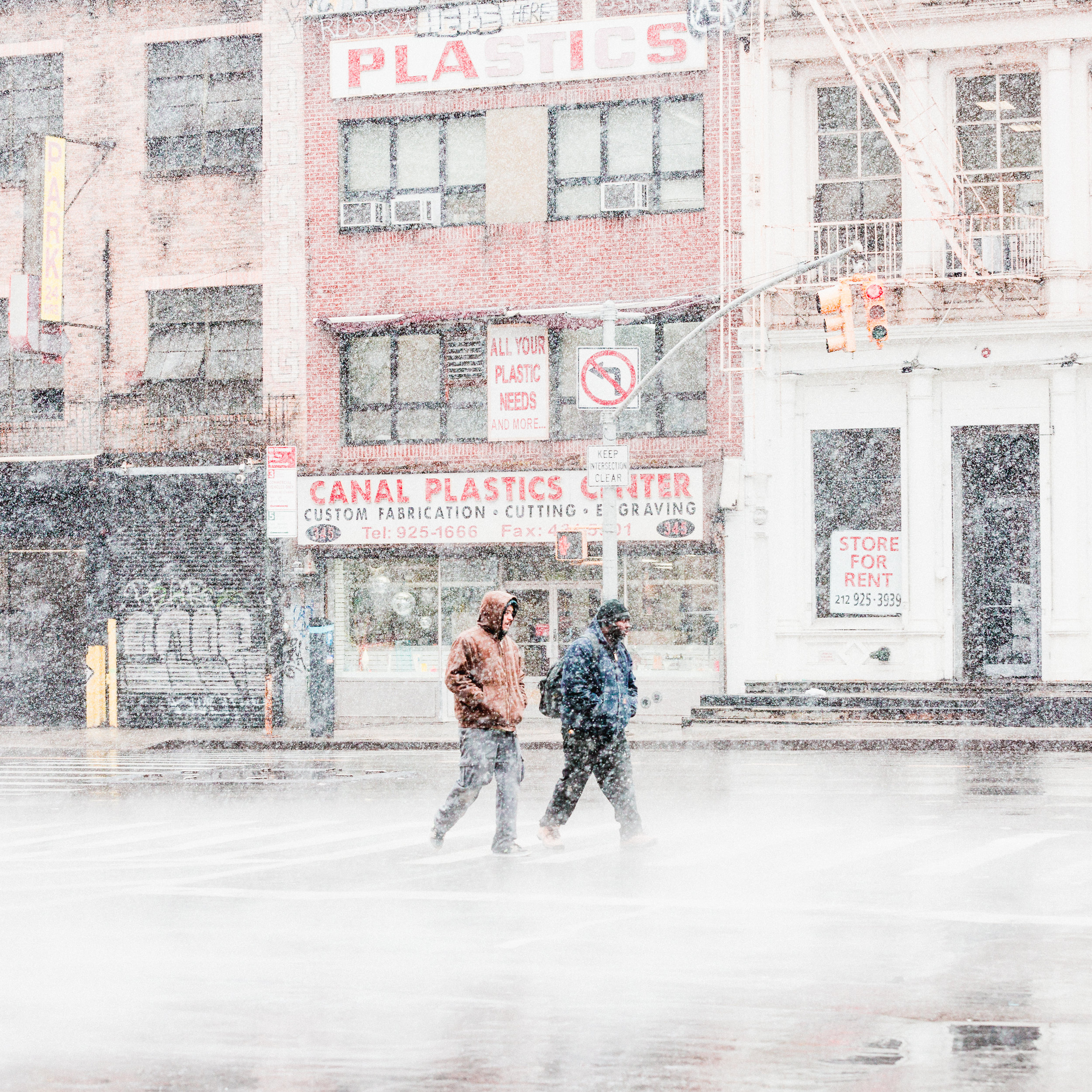 canal street new york downtown walking snowstorm smoke