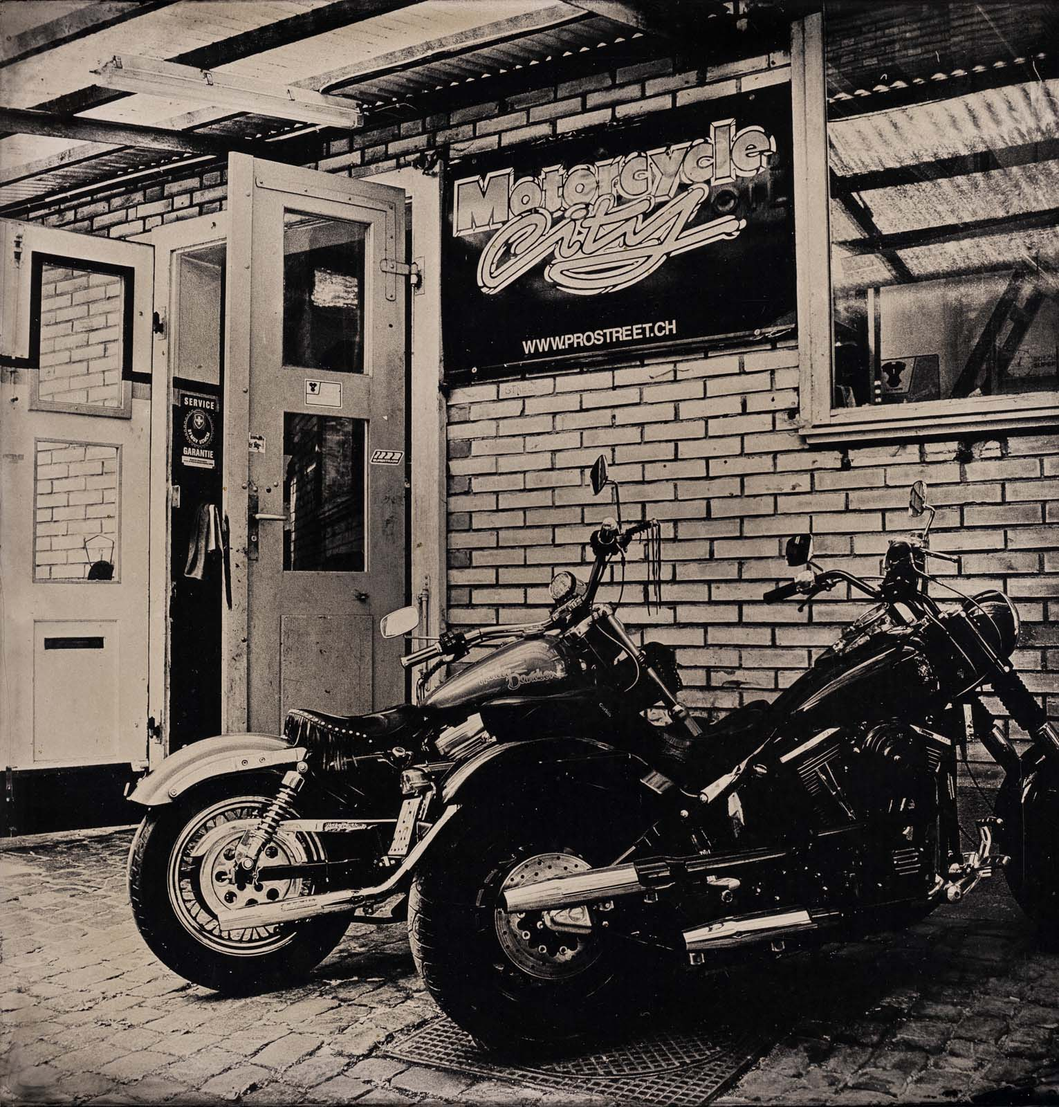 Motorcyclecity Courtyard - By:Marius Kurek