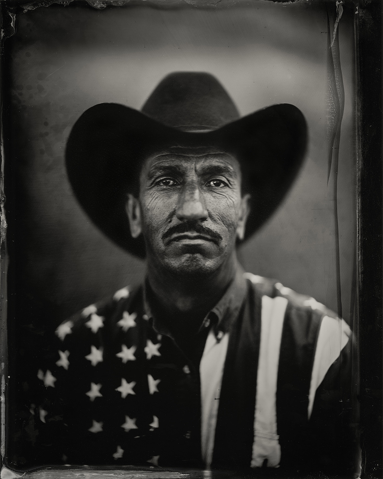"Luis from Quincy WA. - By: Angel Colmenares  chemicalangel.com   I've worked as a photographer in New York and a Cinematographer in Los Angeles for ten years, shot films, commercials, and music videos, but now with Wet Plate,  I learned about Wet Plate in early 2016, I purchased an old Ansco 8x10 camera, found a Dallmeyer lens on eBay, searched for a workshop, and turned an old work trailer into a darkroom.  I met Luis when I was looking to photograph another group of people that are close to my heart, ""Immigrants"". Since I'm a immigrant from Cuba that left because of political reasons, I knew that I wanted to capture the people that cross the border searching for a better life, the people that work the fields, the illegal aliens that take work that no other American would.  I want to photograph people that matter, even when they believe they don't matter, people that struggle for a cause, no matter what cause, people that stand up to adversity, the people that makes America work everyday, and are not recognized by their efforts or creativity, just real people."