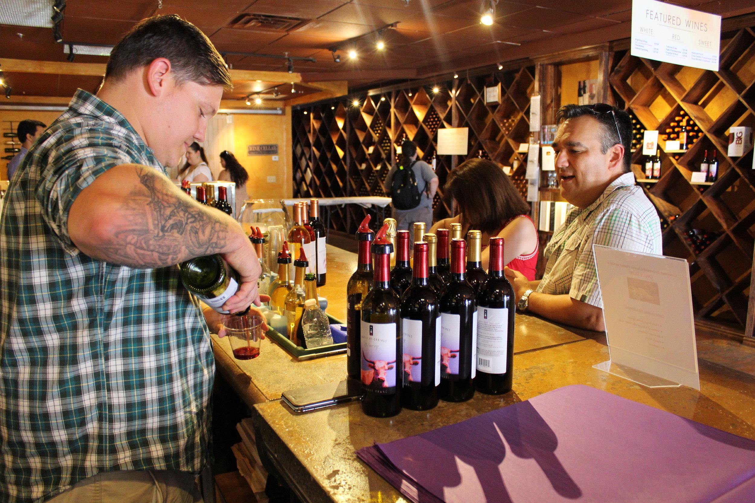 Gentleman_Serving_wine_winery_developers