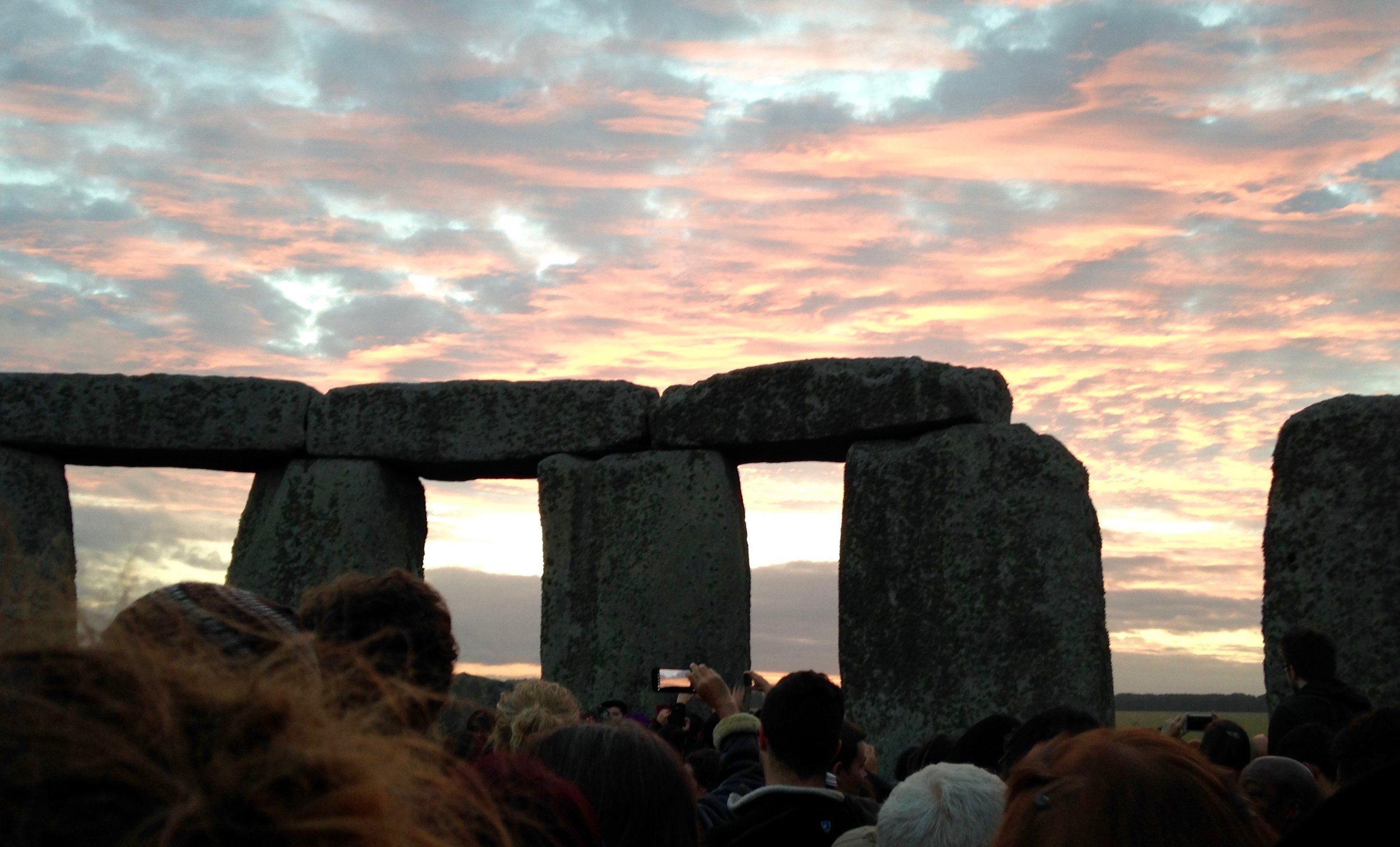 Summer Solstice sunrise at Stonehenge, viewed with ten thousand others.