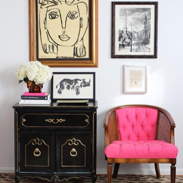 We are currently obsessed with this pink club chair...