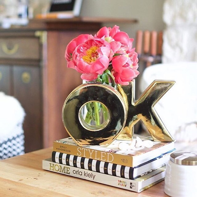 """Two of my favorite things in this (amazingly styled) photo. The book """"Styled"""" by @emhenderson and some goodies from #ohjoyfortarget"""