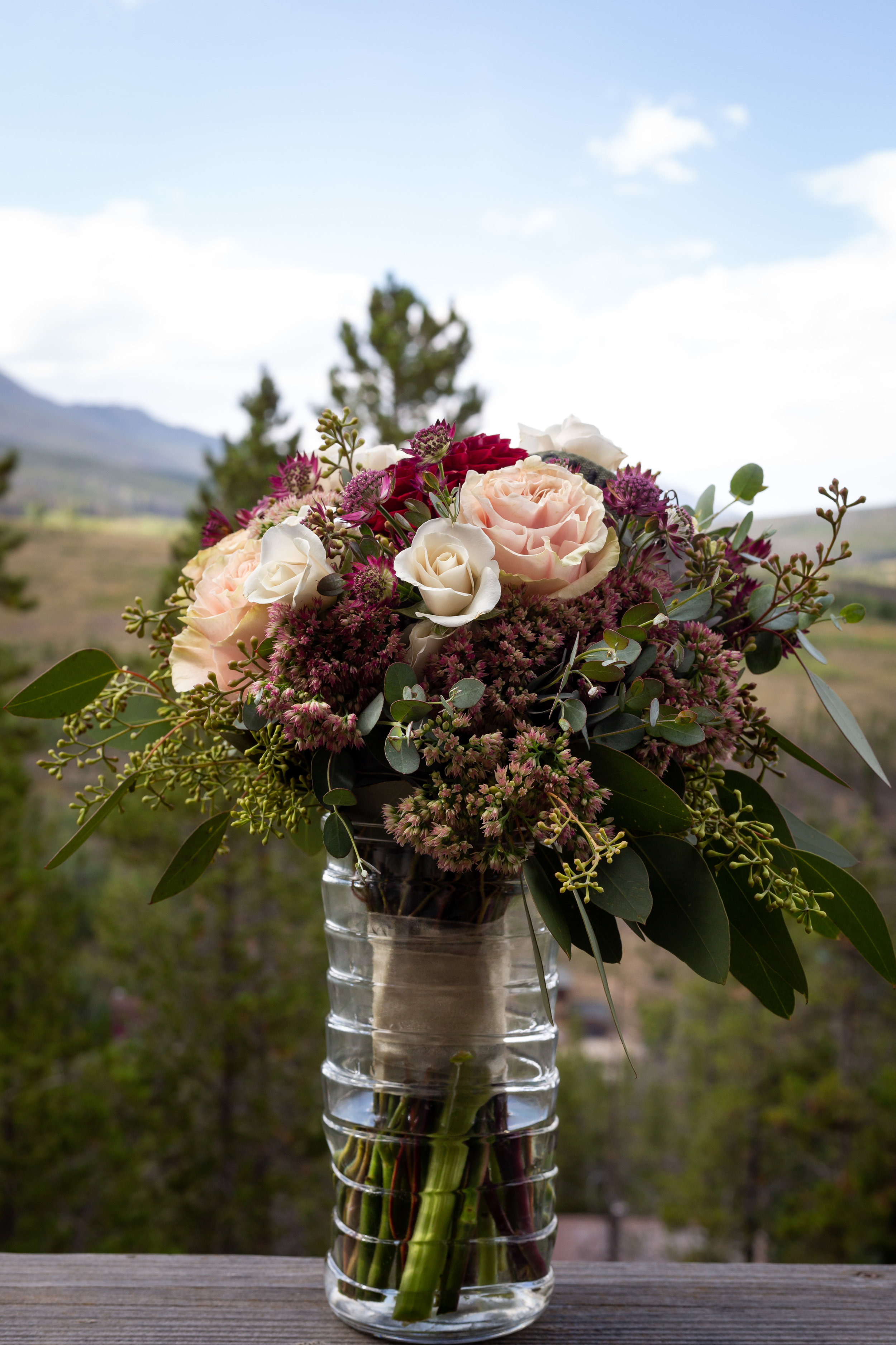 Petal and Bean made such a pretty arrangement for Kayla and Ryan's elopement at Mount Quandary in Breckenridge, CO on August 28, 2018! We loved the mix of the greens, pinks and burgundy. -