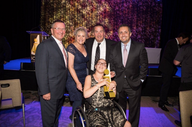 Providing affordable housing for those with developmental disabilities hits home- CIC Founder and CEO, Jim Schmid dedicates his award to his beloved 12-year-old granddaughter Avery. (Pictured left to right: Jim Schmid, Janice Patterson, Senior Project Manager at Emmerson Construction, Inc., Executive Director So. Cal. Housing Collaborative, Nathan Schmid and Kursat Misirlioglu, Director of Project Finance for CIC. Front row: Miss Avery Schmid.)