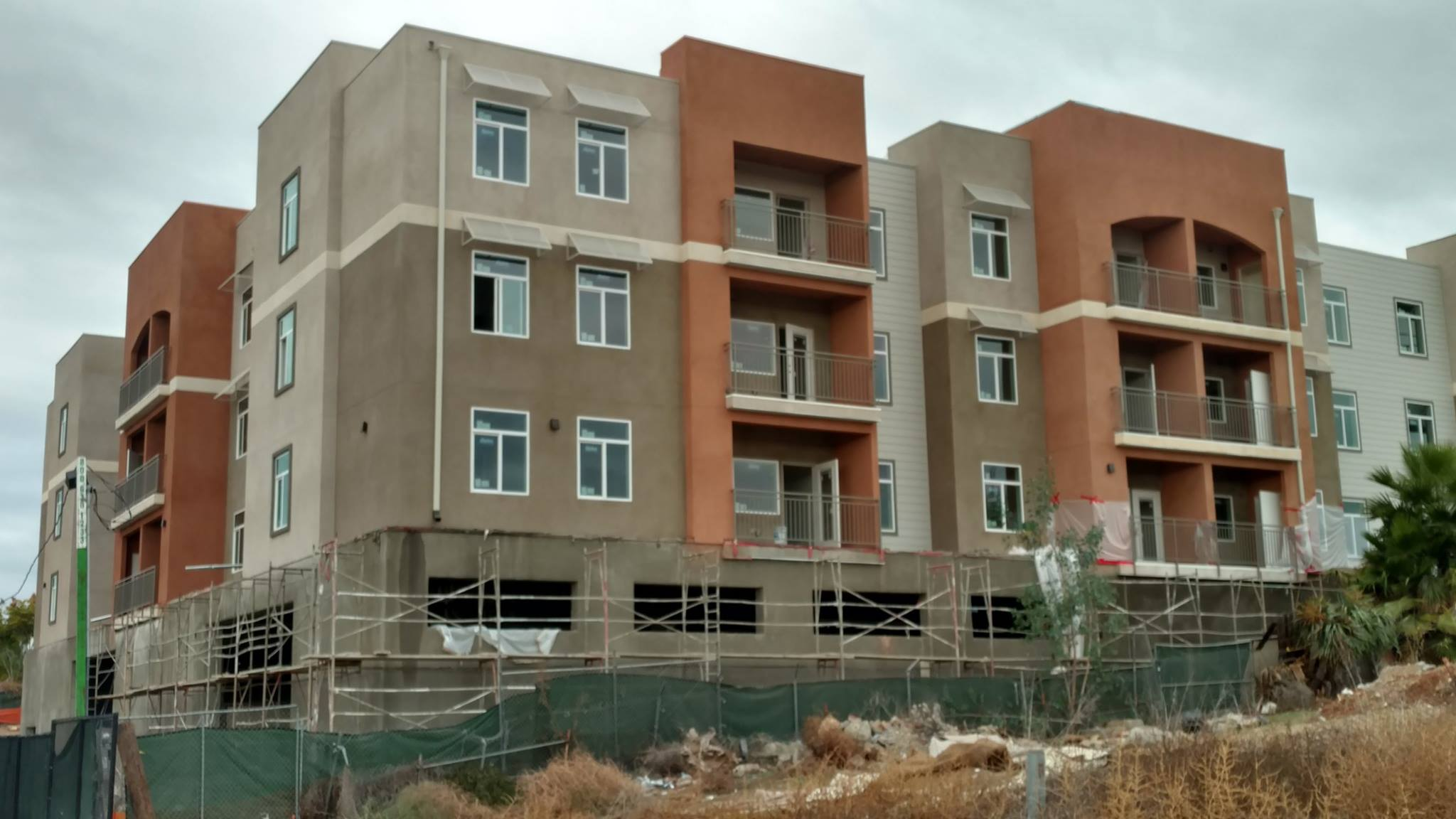 Scaffolding has now been removed from the building's exterior allowing the finished stucco and color to shine through.