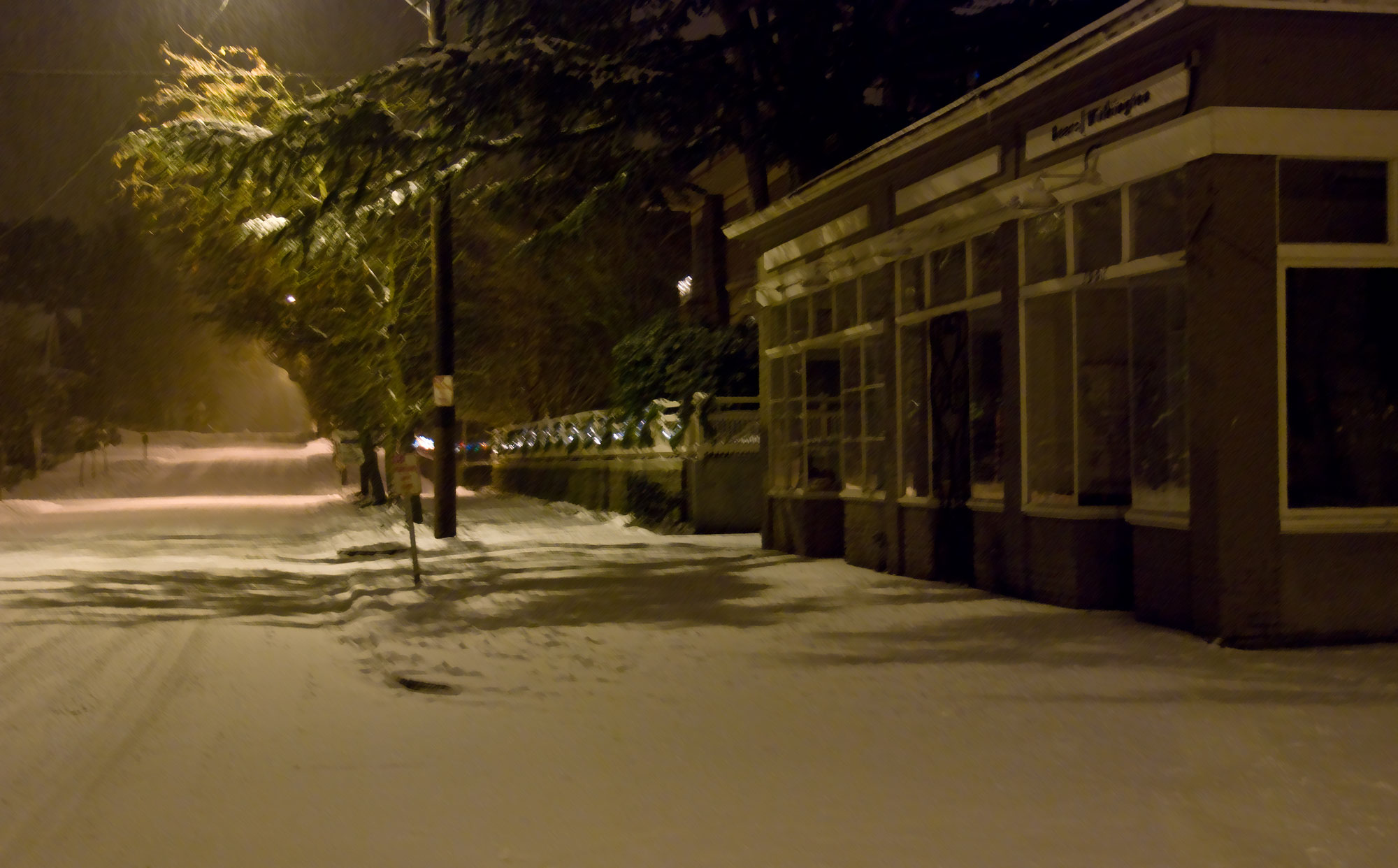Storefronts, snowy night