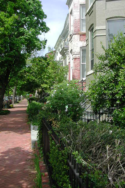 rowhouses and red brick sidewalks