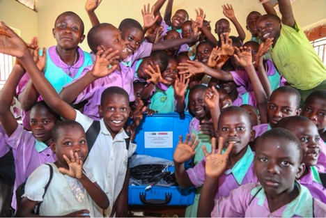 Students celebrate the installation of their Solar Suitcase