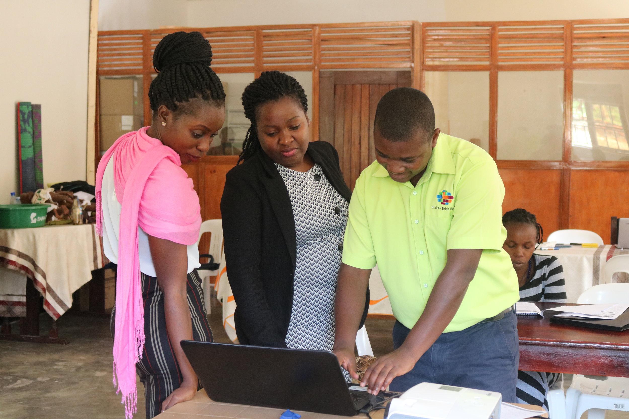 Dr. Eleanor with BAMA Program Officer Esther Nakyaze and Brick by Brick M & E Manager Richard Kimaka