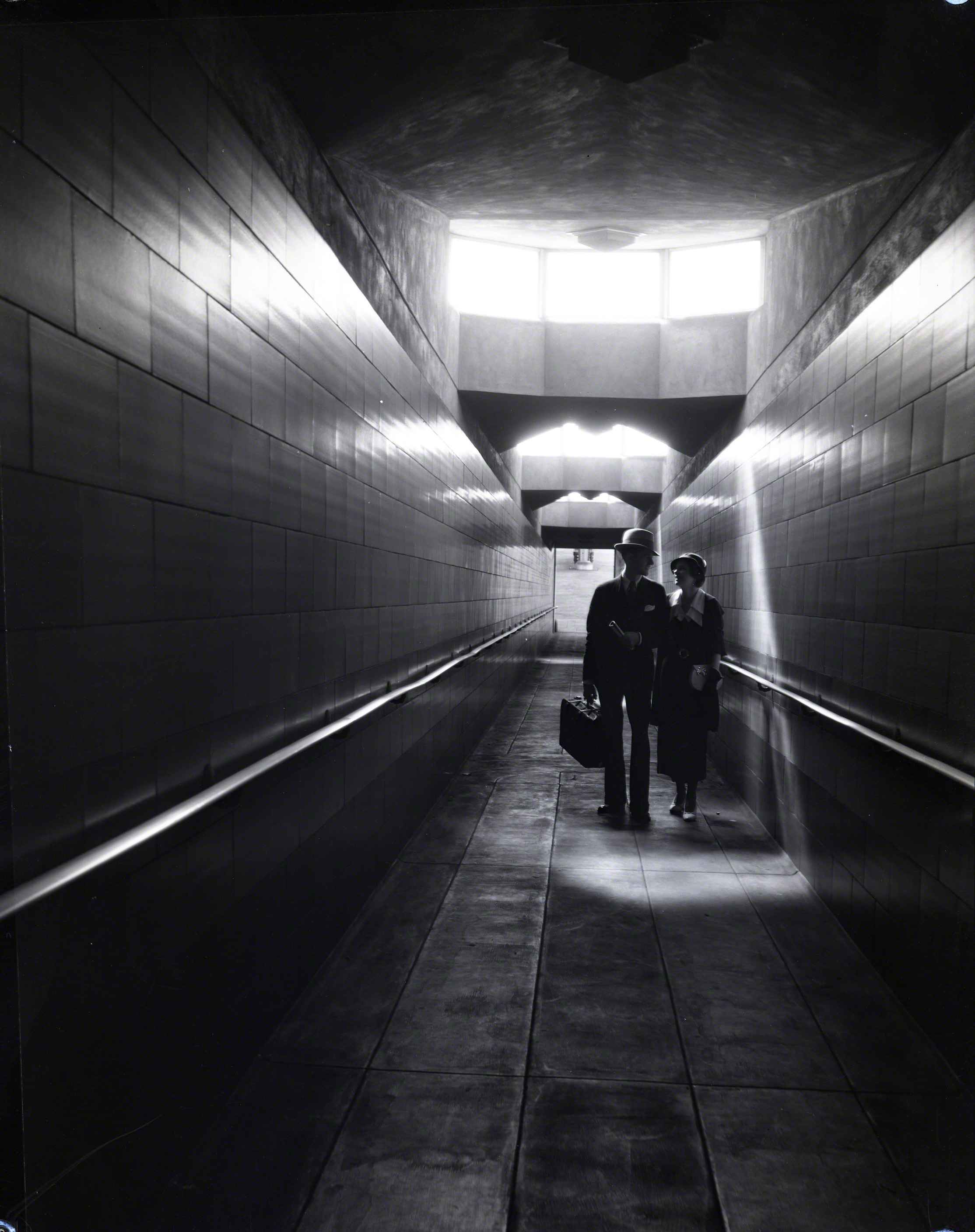 Ramp with People from Concourse to Platform.jpg