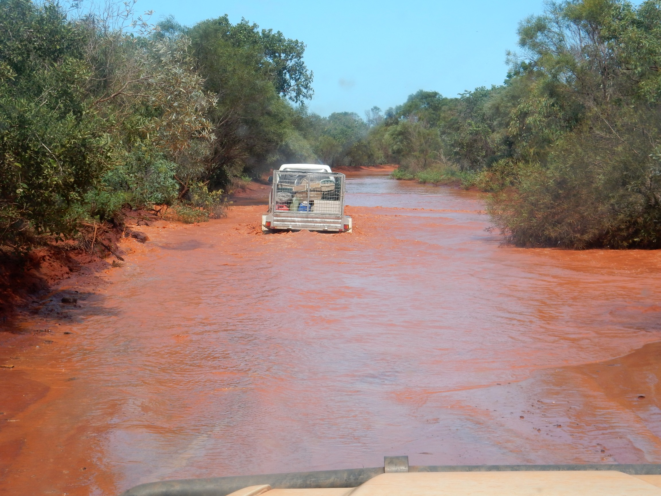 AWSG expedition battling floodwaters along Crab Creek Road. Photo: John Graff