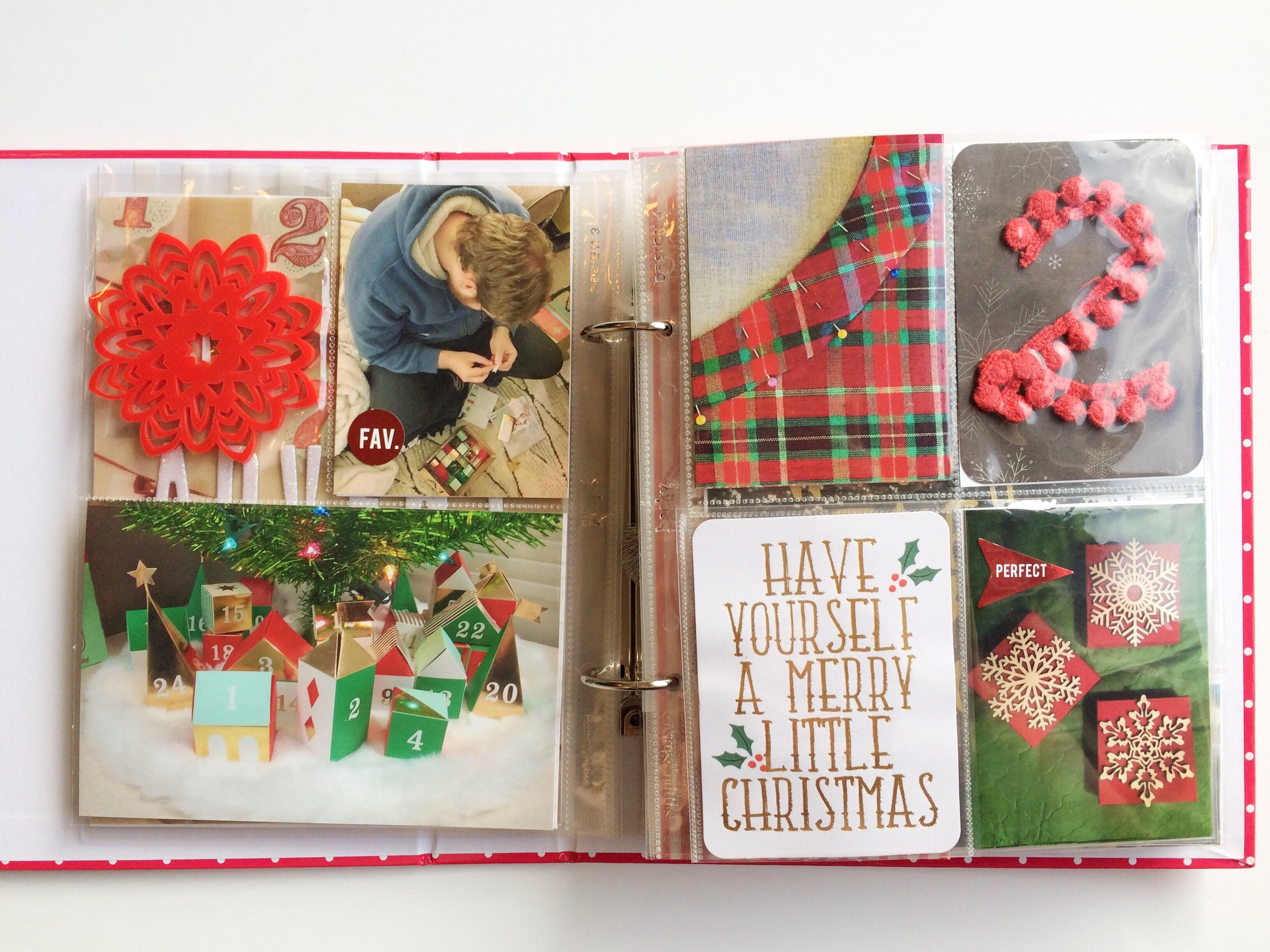 """For day 2 I chose to document the story of making gifts for my mom this year instead of buying them. To break up the page I added a flip up pocket to conceal the journaling under the """"Have Yourself A Merry Little Christmas"""" 3x4."""