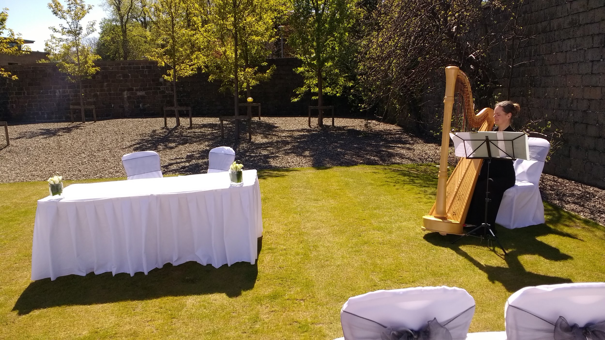 Enjoying the sunshine: setting up for a summer ceremony