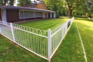 Cricket Pavilion Fencing - As the cricket pitch is rather close to our hearts, it being the genial host of the Dog Show every year, we paid for the rather splendid fencing around the cricket pavilion