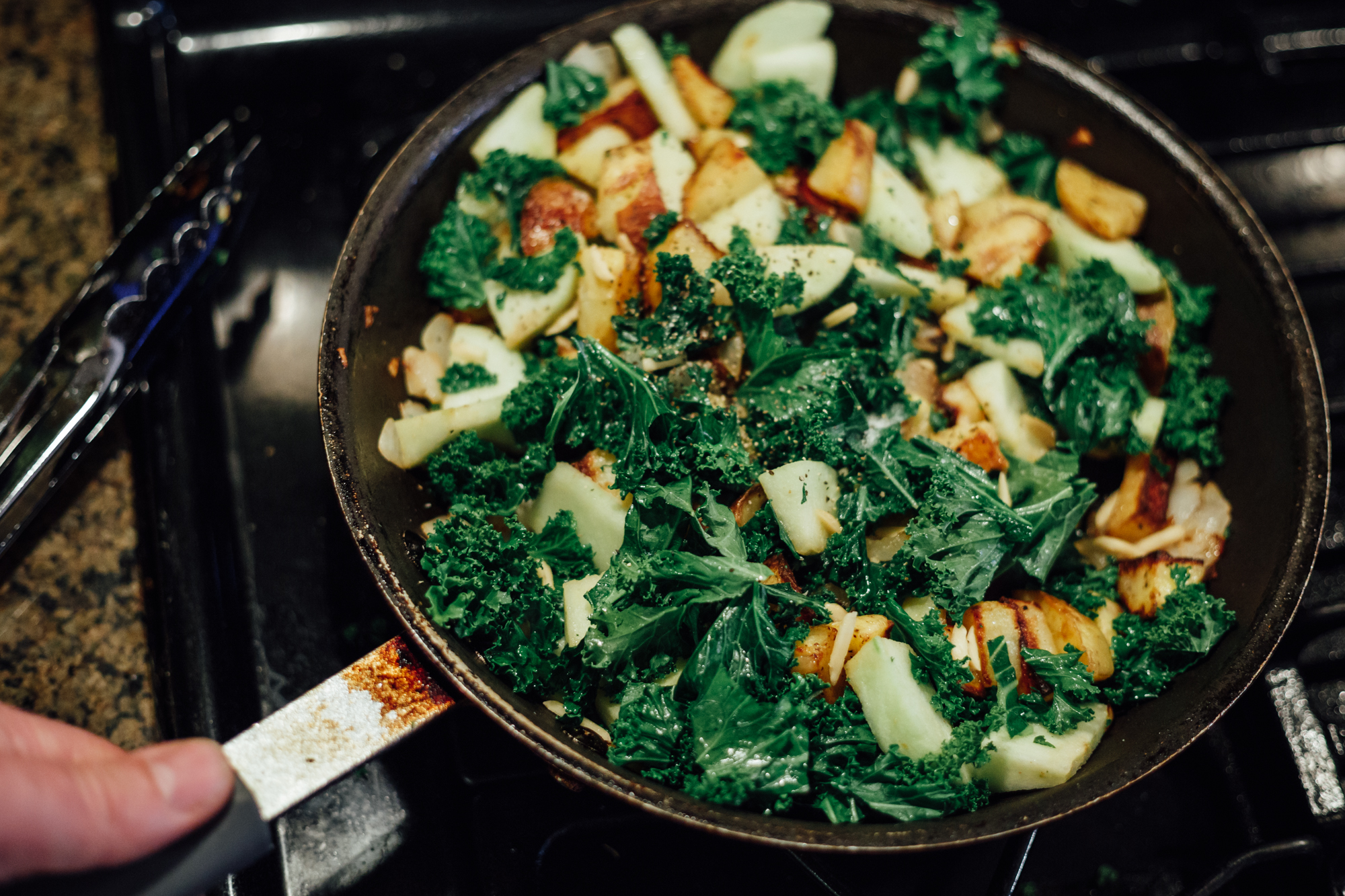 It's all coming together now!I love the combination of colors, textures and smells in this dish. Here I have potatoes, apples, onions, almonds and kale just about to be placed onto a dish, and will top them with a pice of seared chicken.