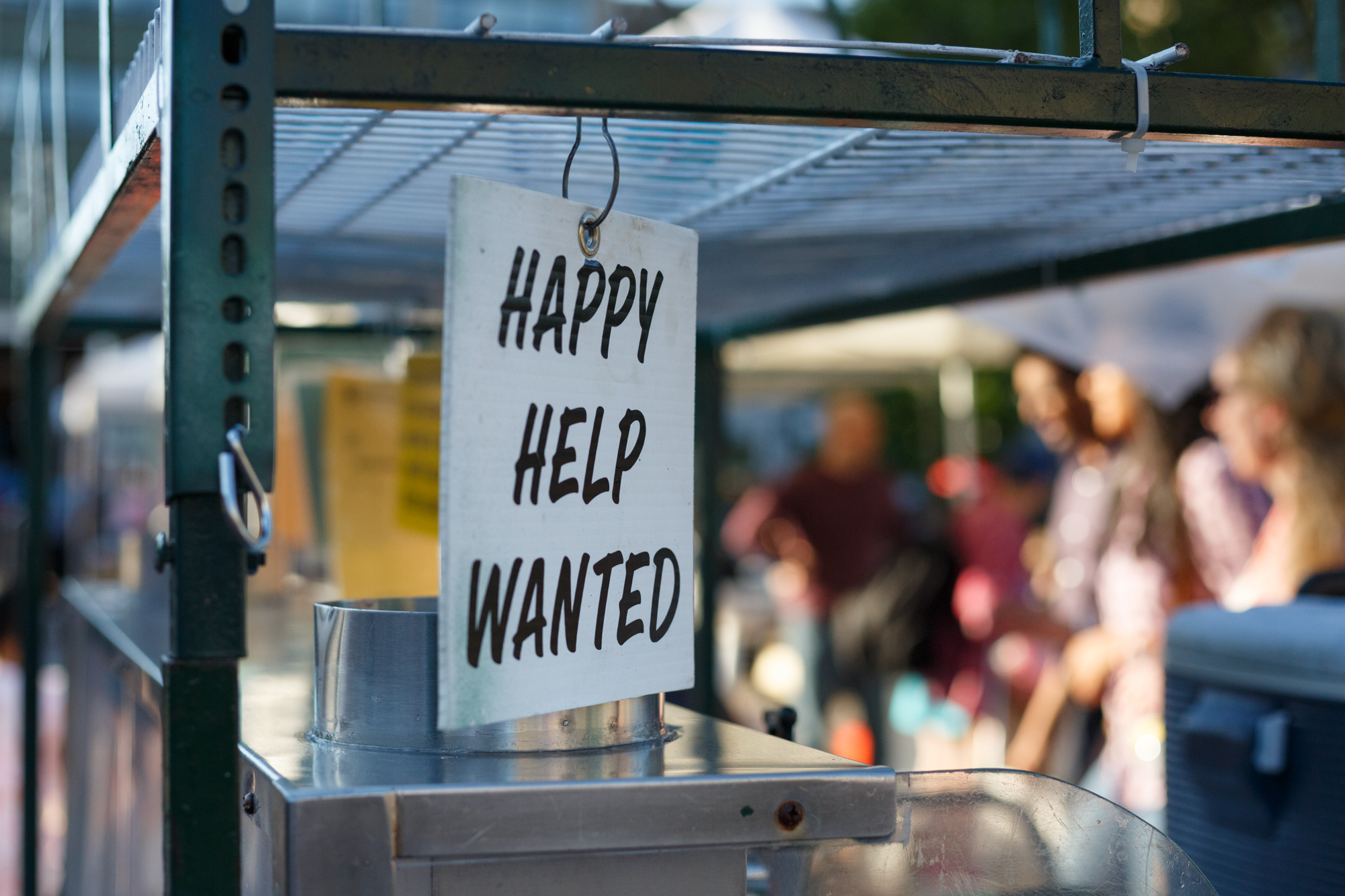 I loved the clarification of the sort of help needed on this sign hanging on an un-manned cart.