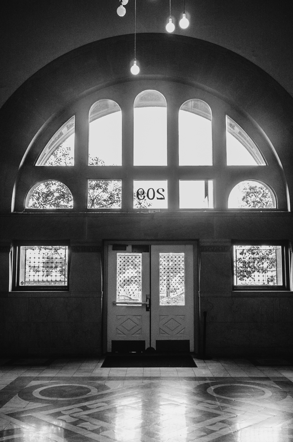 This was once the main entrance to our building... Now, it now acts as a sort of  back room and you can only leave through these doors. It has all the markings of a grand entrance, but no one really enters this way any more. Kind of sad.